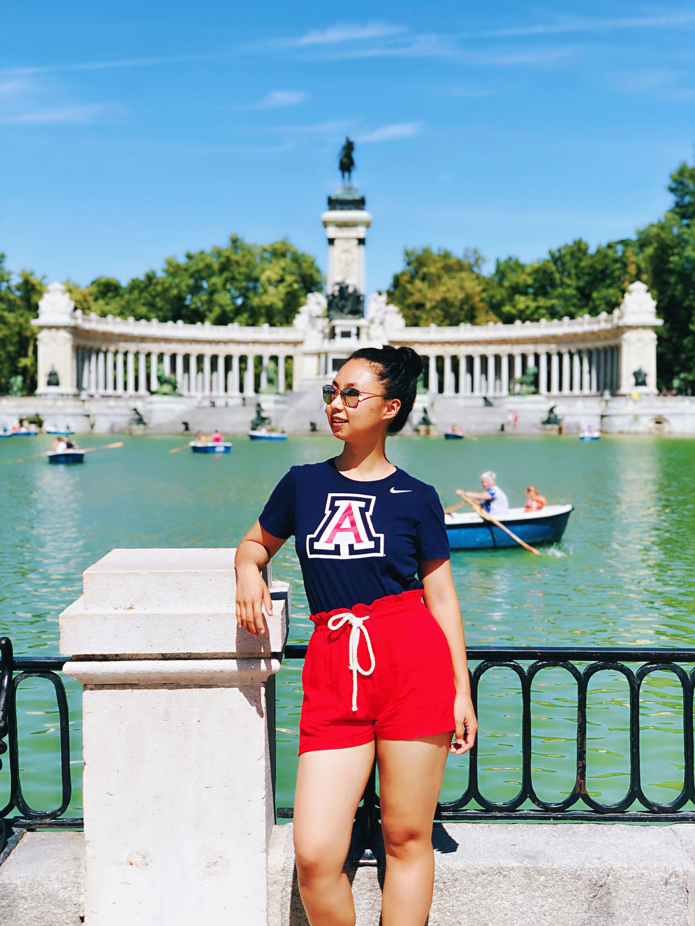 Mandy Han, studying abroad in Madrid, Spain, wearing UArizona shirt and colors, fountain in background