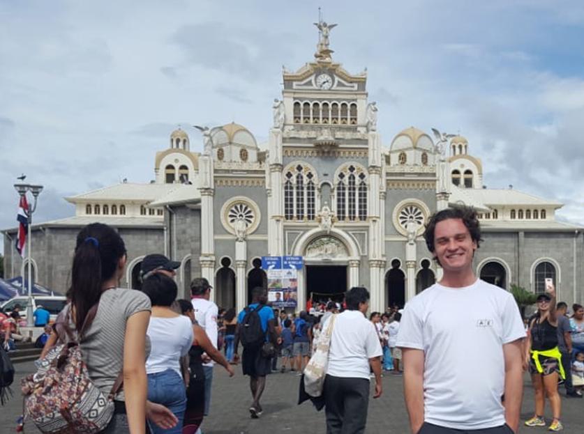 UA Study Abroad Student Brenden Barness in Costa Rica, Basilica square in background.