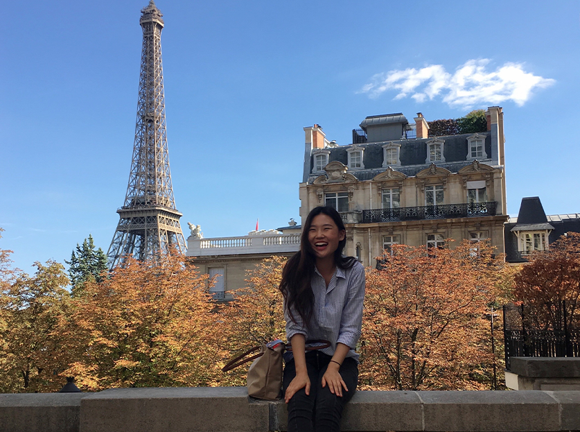 UA Study Abroad Student Stephanie Kim in Paris, Eiffel Tower in background.