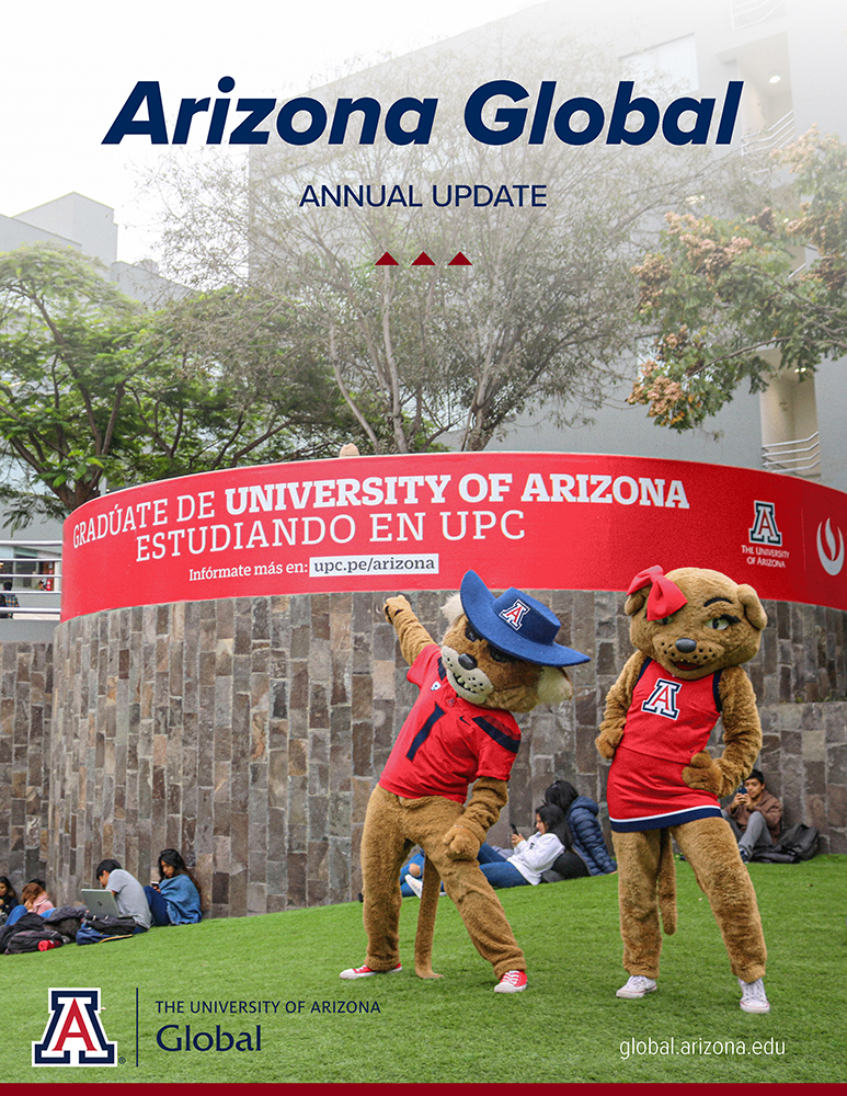 Arizona Global 2021 Annual Update cover with photo of Wilbur and Wilma Wildcat with banner sign at UPC