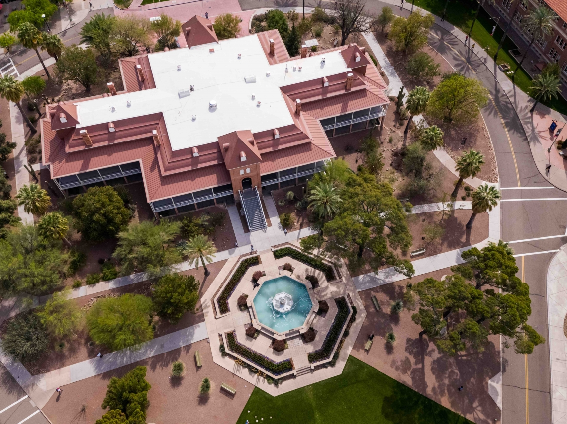 Aerial shot over Old Main building with view of the fountain
