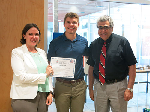 Julie Ellison-Speight, left, presents a HIVE certificate to senior Jackson David Graff, center, alongside Nader Chalfoun (right)