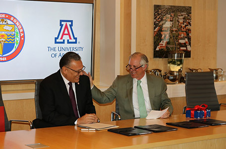 President Robbins Signs Agreement