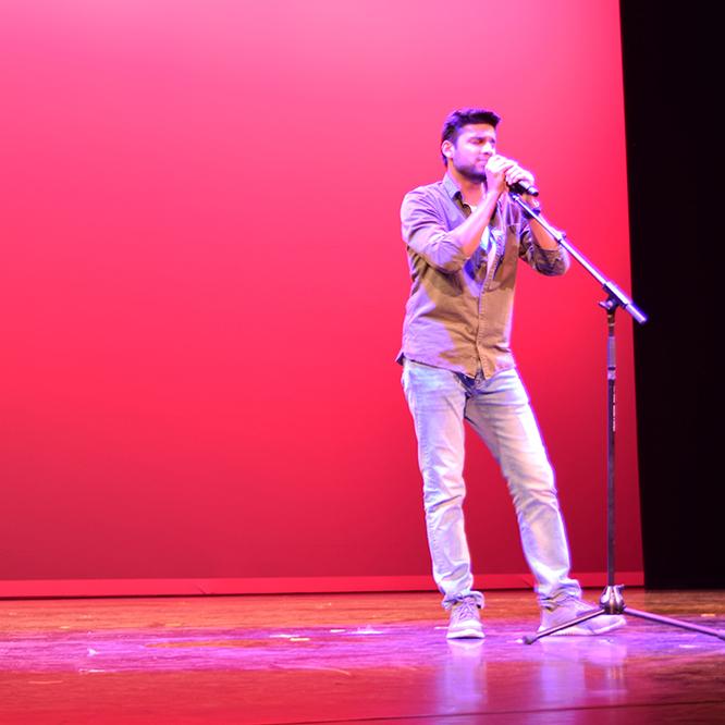 Global Wildcats Got Talent performer singing
