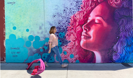 Nadia Alvarez Mexia walks by a mural in Tucson painted by Ignacio