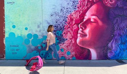 Nadia Alvarez Mexia walks by a mural in Tucson painted by Ignacio