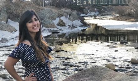 Hadiqa Maqsood by a frozen river.