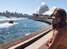 Arizona Alumna Dominique standing in front ot the Sydney Opera House