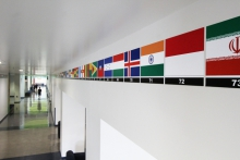 A hallway bears decals of flags from 167 countries.