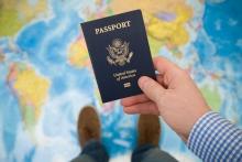 an image of a man holding a passport