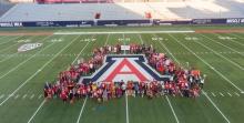 Students pose for a large group photo at Arizona Stadium during International Education Week 2017