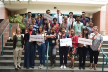 the first international scholar academy poses outside the university services building.