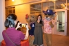 Party at Global Fall 2021 - Student getting photo taken with Wilma and Wilbur Wildcat