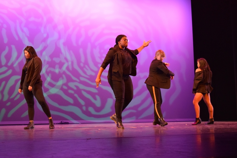 Four females dancing at Global Wildcats Got Talent