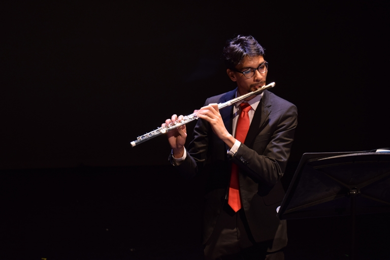 Male performer on flute at Global Wildcats Got Talent