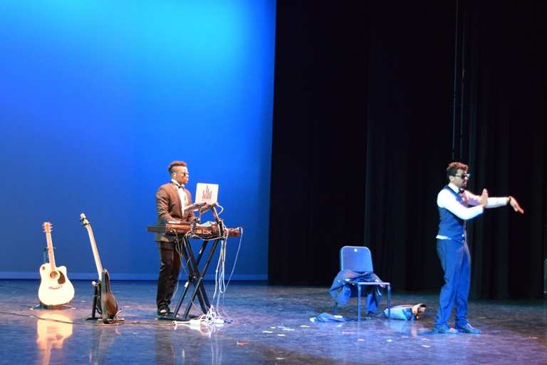 Two male performers DJ and dancing at Global Wildcats Got Talent