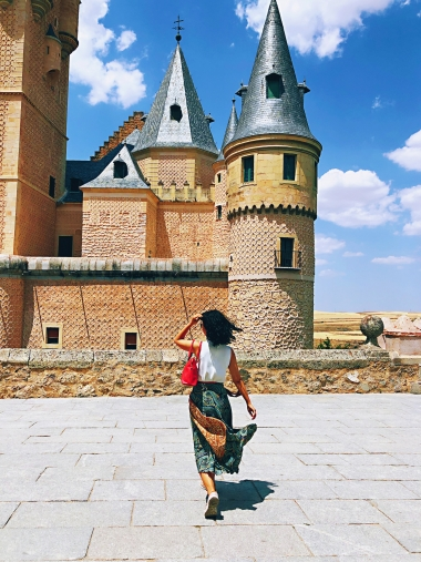 Mandy Han, studying abroad in Spain, pictured in Segovia with castle in background