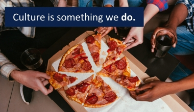 Students eating a pizza together and the words: Culture is something we do.