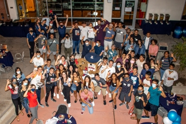 International students group photo with Wilbur and Wilma Wildcat at the 2021 Global Wildcat Welcome Party