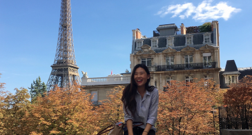 UA Study Abroad Student Stephanie Kim in Paris, Eiffel Tower in background.