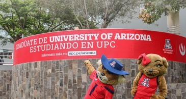 Arizona Global 2021 Annual Update cover with Wilbur and Wilma Wildcat with banner sign at UPC